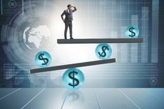 The businessman balancing in financial dollar concept Stock Photography