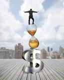 Businessman balancing on hourglass and dollar sign Stock Image