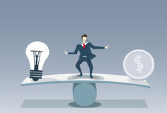 Businessman Balancing Between Light Bulb And Money Coin Risk Business Stability Concept Stock Photo