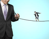 Businessman balancing on line Royalty Free Stock Photography