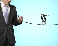 Businessman balancing on line Royalty Free Stock Photography