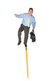 Businessman balancing on pencil Royalty Free Stock Photo