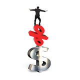 Businessman balancing on red percent symbol and dollar sign Royalty Free Stock Image