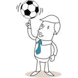 Businessman balancing soccer ball on his finger Royalty Free Stock Photos