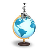 Businessman balancing stack money symbols on terrestrial globe Royalty Free Stock Image