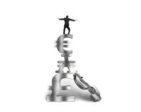 Businessman balancing on stack money symbols Stock Photo