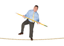Businessman balancing on tightrope Stock Photo