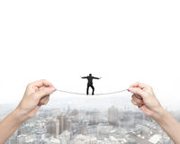 Businessman balancing on tightrope with woman two hands holding Stock Images