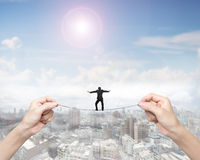 Businessman balancing on tightrope with woman two hands holding Stock Image