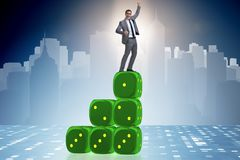 Businessman balancing on top of dice stack in uncertainty concep. T Royalty Free Stock Photo