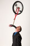 Businessman balancing unicycle Royalty Free Stock Images