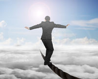 Businessman balancing on a wire with sky sub cloudscape Stock Photos