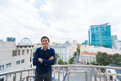 Businessman on balcony Stock Photo