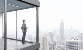 Businessman on balcony Royalty Free Stock Photography