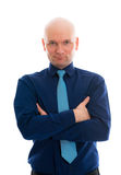Businessman with bald head and crossed arms. Young businessman with bald head and crossed arms in front of white background Stock Image