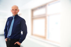 Businessman with bald head in front of white background Stock Photos