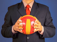 Businessman with ball Stock Photography