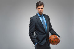 Businessman with ball against gray background Royalty Free Stock Photo