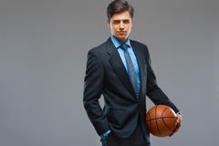 Businessman with ball against gray background Stock Photo