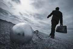 Businessman With Ball And Chain Royalty Free Stock Image
