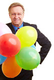 Businessman with balloons Royalty Free Stock Images