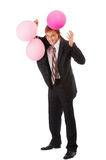 Businessman with balloons. Full-length portrait of happy businessman with balloons Stock Images