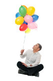 Businessman with balloons Stock Photography