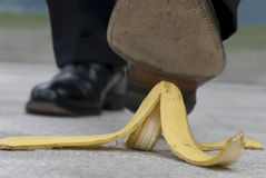 Banana peel accident : businessman stepping on banana skin Stock Images