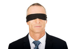 Businessman with band on eyes Royalty Free Stock Photography