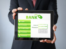 Businessman with bank application  on a tablet Stock Photography