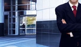Businessman and bank office building Royalty Free Stock Photo