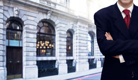Businessman and bank office building Stock Photography