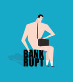 Businessman bankrupt, debtor. Sad businessman sitting on tax. Na Royalty Free Stock Photography