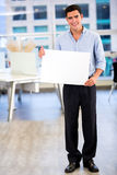 Businessman with a banner Royalty Free Stock Photo