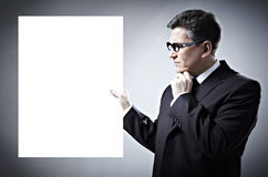 Businessman with a banner. Royalty Free Stock Photography