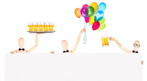 Businessman with banner, balloons and beer Stock Photo