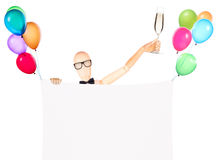 Businessman with banner, balloons and champagne Royalty Free Stock Image