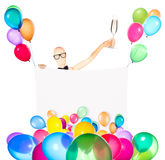 Businessman with banner, balloons and champagne Stock Photo