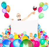 Businessman with banner, balloons and wine Stock Images