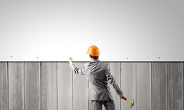 Businessman and banner on wall Stock Photos