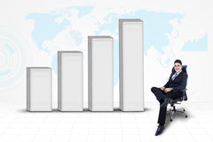 Businessman with bar chart and world map background Stock Photography