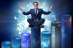 The businessman on the bar charts in business concept Stock Photography