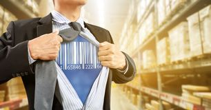 Businessman with barcode reader in warehouse. Logistics stock photo