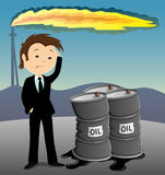 Businessman and barrels with oil. Stock Photography