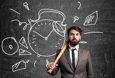 Businessman bat and clock Royalty Free Stock Image