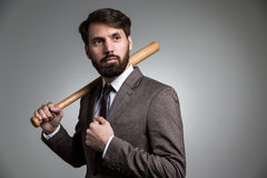 Businessman with bat on shoulder Royalty Free Stock Photo