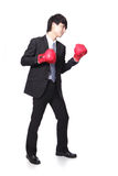 Businessman battle with boxing glove Stock Photo