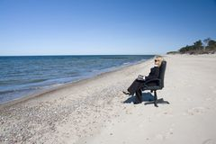 Businessman on beach Royalty Free Stock Photography