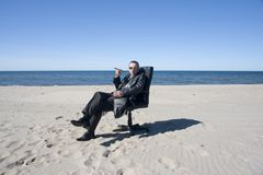 Businessman on Beach Stock Image