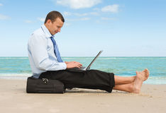 Businessman  on the beach Royalty Free Stock Images